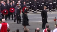 Remembrance Sunday at Cenotaph Politicians stand with wreaths as soldiers stand to attention / Queen Elizabeth II passes Cenotaph with King...
