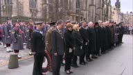 Remembrance Sunday in Edinburgh St Giles Cathedral in background / Soldiers and dignitaries stand for minute silence