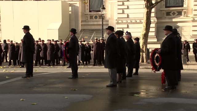 Royals and politicians at Cenotaph ENGLAND London Whitehall EXT Exserviceman wearing bowler hats / people watching from balconies overlooking...