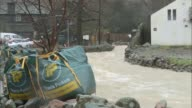 Cumbria and Conwy scenes Glenridding Swollen river flowing under bridge / fire engine outside Glenridding Hotel / fastflowing river / two men along...