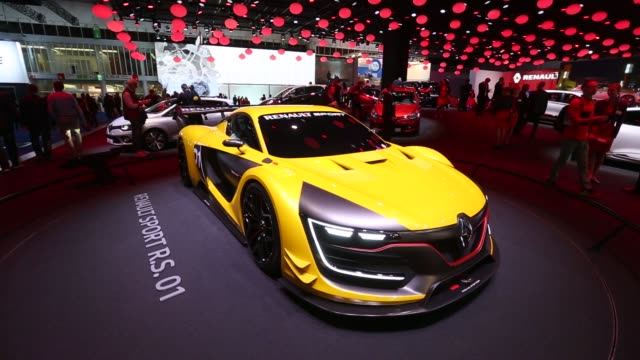 Renault sports cars sit on display at the IAA Frankfurt Motor Show in Frankfurt Germany on Tuesday Sept 16 2015 Shots A yellow Renault Sport RS01...