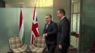 David Cameron meets Hungarian PM BELGIUM Brussels INT David Cameron MP walking into office with Viktor Orban / chatting during photocall