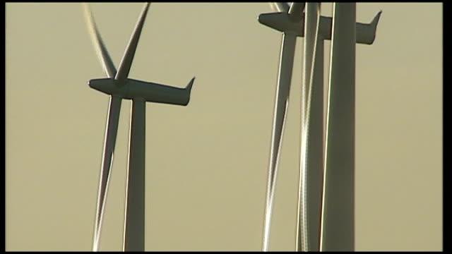 wind farm in rural Texas Good shots of rotating aerodynamic turbine blades / General views wind turbines wind farm / Sign for 'Farm road' and wind...