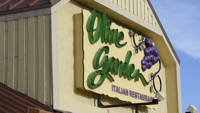 Reno Nevada US March 19 2015 Photographer David Paul Morris Signage is displayed at an Olive Garden restaurant in Reno Nevada US Shot pans across a...