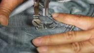 Repair denim with sewing machines.