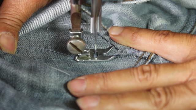 Repair denim with sewing machines.