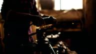 Repairman using a grinder