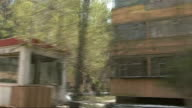 Report on Uighur Muslim minority Xinjiang Urumqi Tracking shot along past apartment complex which Chinese police raided in January 2008