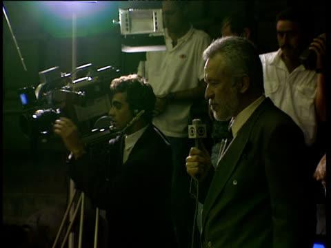 Reporter and cameraman filming proceedings in parliament Brasilia
