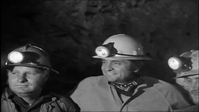 Reporter interviews Johnny Cash in the underground Gold mine about his experience being down 900ft never been down that deep before Cash speaks about...