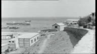 Aden report on likely problems after independence Night People relaxing at tables by the sea Little Aden Day Soldiers at tables and lounging in...