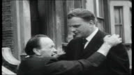 Billy Graham's Greater London crusade ENGLAND London Brixton EXT Graham meets strange old man who had been attacked by dogs and asks him to find God...