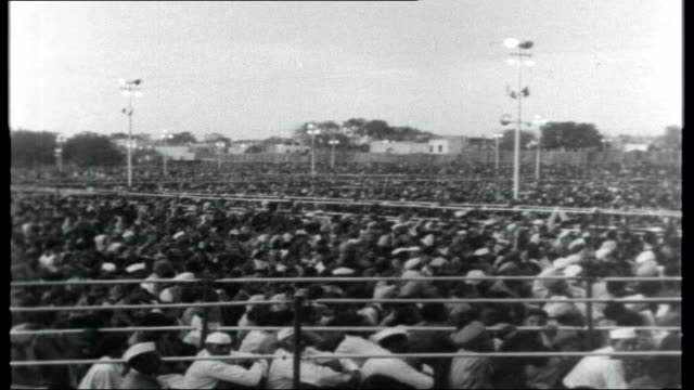 India Mrs Gandhi Elected Premier INDIA Delhi EXT PAN across large crowd gathered Reporter sitting with Indira Gandhi Indira Gandhi interview SOT...