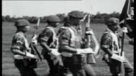 Indonesia Sukarno stripped of life Presidency Troops during military ceremony marching towards past Troops run forwards with rifles Group with rifles...