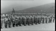 Morocco Spanish Foreign Legion Outposts SPAIN / MOROCCO Ceuta EXT Franco's Spanish foreign legion troops on parade singing and marching with flags...