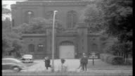 Nazi prisoners in Spandau WEST GERMANY Berlin Spandau EXT Prison officer stands guard outside entrance to Spandau prison