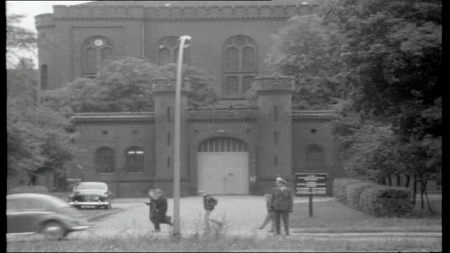 Nazi prisoners in Spandau WEST GERMANY Berlin Spandau EXT Prison officer stands guard outside entrance to Spandau prison