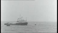 Sea Gem disaster Reporter to camera Supply ship moored to wrecked leg of rig at sea Cleethorpes Royal Dock Tug 'Englishman' moored at quay due to bad...