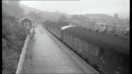 The way to Braybrook Street the life of Harry Roberts AIR VIEW train along through countryside Train along WALES Monmouthshire Llanbradach station...