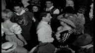 West Germany preLent carnival festivities Girls in fancy dress lead parade with high kicks at final Fasching Ball Princess speaking into mic at ball...