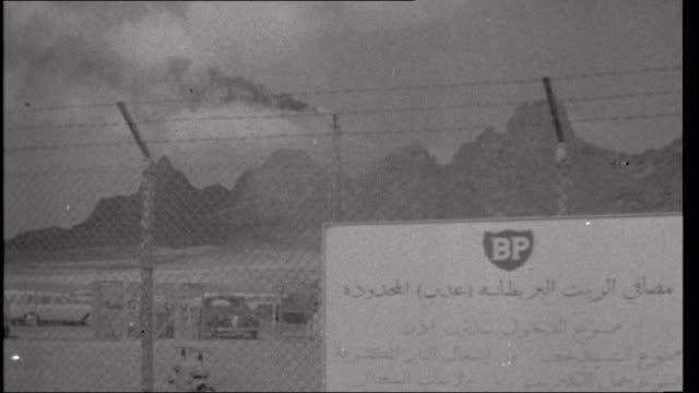 Aden Terrorism British Troops AIR VIEW AERIAL Aden skyline with mountains in distance/ GRAPHIC showing map of Aden/ AIR VIEW oil refinery/ various of...