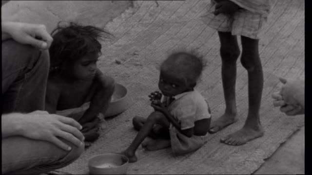 Famine in Bihar INDIA Bihar EXT Shots of starving children as Minkin and Edwards visit nearby village to Kwacala Minkin interview in front of...