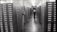 Search for Martin Bormann WEST GERMANY Wiesbaden Police Headquarters Police officer looking at file in rows of filing cabinets TRACK BACK / Police...