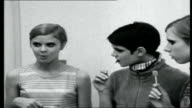 Twiggy in America Four girls standing dressed in Twiggylike clothes and short haircuts and sucking on lollipops Four girls interviewed SOT On the...