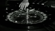 Monaco Expanding For Tourism MONACO Monte Carlo INT **Please note this clip is mute throughout** Roulette wheel spinning Hand stops wheel Chips being...