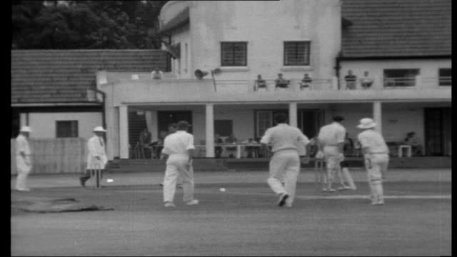 Rhodesian diary People watching concert in bandstand in park Cricket match in progress Men playing golf Women and children fishing at water's edge...