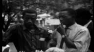 Rhodesian diary RHODESIA Salisbury EXT Rhodesians gathered in streeet as listening to broadcast of Ian Smith declaring UDI Members of Rhodesian armed...