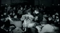 Skiing in Austria INT Shots of students revelling at apresski dance in bar / Lady Mary Kerr and her brother the Marquess of Lothian singing Woody...