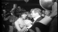 Snowdons in Hollywood Shots of people on dancefloor at Charity Ball / Various of Lord Snowdon dancing / High shot of ballroom