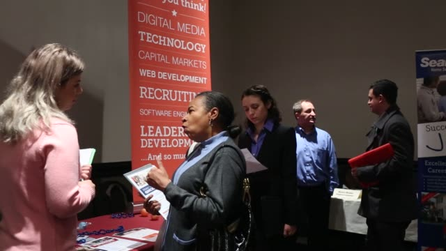 Representatives from various companies speak to job seekers at a Giant Job Fair in Detroit Michigan US on Wednesday Dec 30 2015 The US Department of...