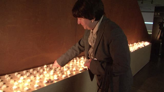 Representatives of Russias Jewish community lit candles at the new Jewish Museum and Tolerance Centre in Moscow to mark the International Holocause...