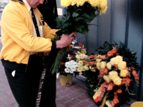 Representatives of the Australian Olympic team lay flowers outside Block 31 in the Munich Olympic village after 11 Israeli athletes were murdered by...