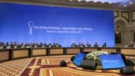 Representatives of the Syria regime and opposition groups along with other attendees take part in the sixth round of Syrian peace talks in Astana...