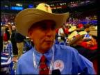 Republican convention/protests ITN People in cowboy hats shirts PAN Rob Peese interview SOT he's cut taxes he's improved education he's done welfare...