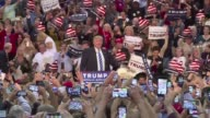 Republican frontrunner Donald Trump targets immigration Obamacare and his Democratic contender rivals at a presidential campaign rally that saw the...