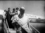 POLITICS Republican nominee for president Fivestar General Dwight D 'Ike' Eisenhower walking down Eastern Airlines aircraft steps men holding up...