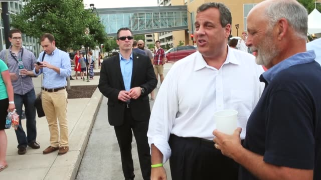 Republican presidential candidate New Jersey Governor Chris Christie greets people gathered at Western Gateway Park for the Italian American Heritage...