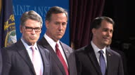 Republican presidential contenders arrive in New Hampshire for debate Shows interior shots Republican candidates on stage audience applauding as they...