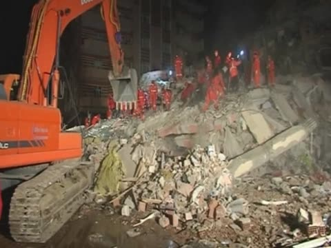 Rescue team dig into concrete to find survivors of the earthquake in Turkey