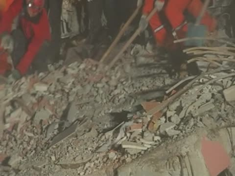 Rescue team dig into the rubble to find survivors of the earthquake in Turkey