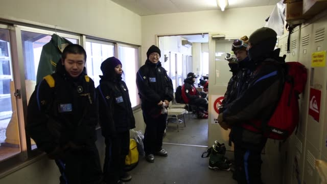 Rescuemen wear boots ahead of the day's operation at the Niseko Hanazono resort operated by Nihon Harmony Resorts KK in Kutchan Hokkaido Japan on...