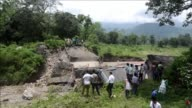 Rescuers are digging through piles of debris to search for survivors after landslides triggered by heavy rain killed at least 30 people across...