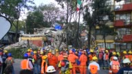 Rescuers are seen during their rescue efforts in the rubble of the multifamily apartments on Tlalpan Avenida due to the earthquake that struck Mexico...
