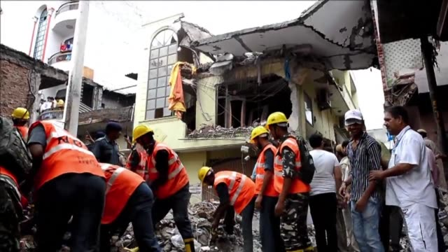 Rescuers in the Indian capital on Sunday scrambled to find a little girl in the ruins of a four storey building after its collapse killed four people...