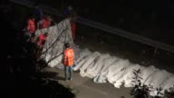 Rescuers line up the bodies of victims of a bus crash on July 28 2013 on the road between Monteforte Irpino and Baiano southern Italy CLEAN Thirty...