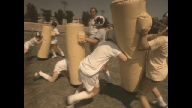 Reseda Rams hitting the bags at the Roman Gabriel Football Camp at Occidental College At the time Roman Gabriel Jr was a player for the Los Angeles...